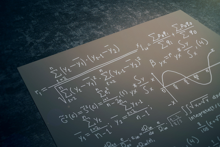 Close up of black paper sheet with mathematical formulas placed on dark desktop. Math concept. 3D Rendering Banco de Imagens - 75734280