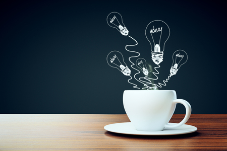 Close up of coffee cup with abstract light bulb drawings. Idea concept. 3D Rendering Stock Photo