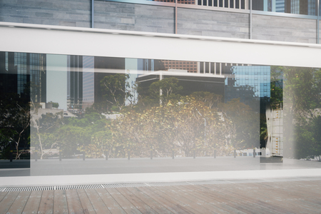 boutique display: Close up of empty glass storefront in daylight. Advertisement concept. Mock up, 3D Rendering