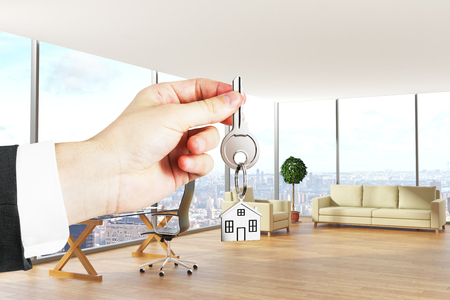 Hand holding key with house keychain in modern office interior with city view. Real estate concept. 3D Rendering Stok Fotoğraf