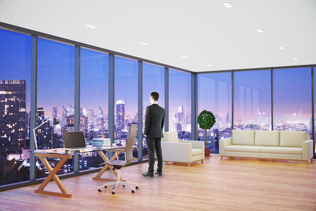 office furniture: Thoughtful businessman in modern office interior with workplace, lounge area and night city view. Research concept. 3D Rendering