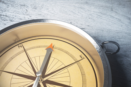 Close up of amber compass on light surface. Orienteering concept. 3D Rendering Stok Fotoğraf