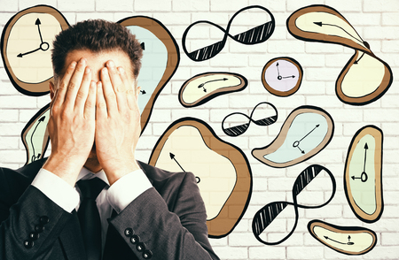 Abstract surrealistic clock drawing and stressed businessman on brick background. Time management concept