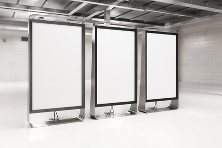 Side view of modern light interior with three blank ad stands. Mock up, 3D Rendering