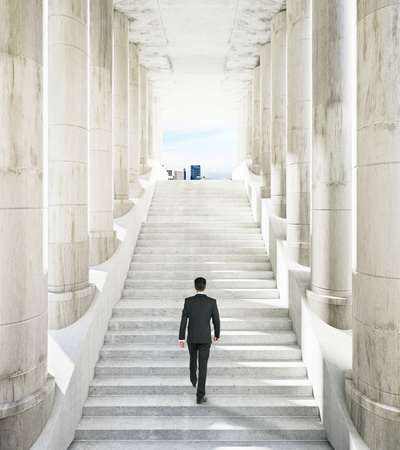 Ancient marble columns and businessman on stairs leading to city. Success concept. 3D Rendering Stock Photo