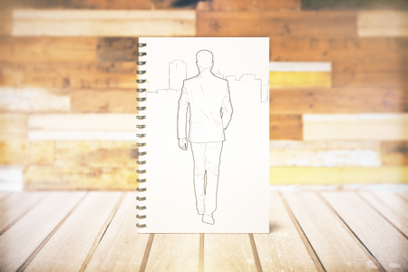 Front view of spiral notepad with walking male sketch. 3D Rendering