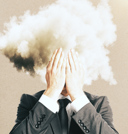 Stressed businessman with cloud instead head