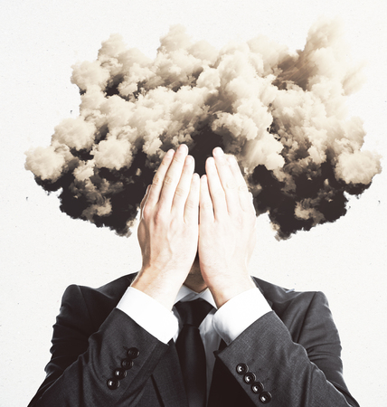 Stressed man with cloud instead head