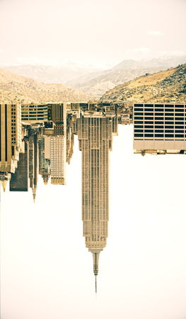 down town: Abstract image of upside down city and landscape on white background