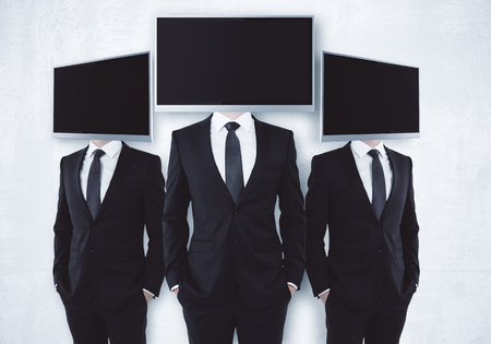 Three screen headed businessmen on concrete background. Mock up