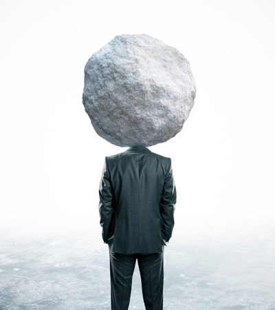 Back view of rock headed businessman on abstract background. Problem concept Reklamní fotografie
