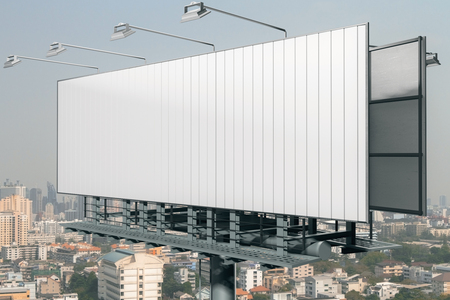Side view of empty billboard on city background. Advertisement concept. 3D Rendering