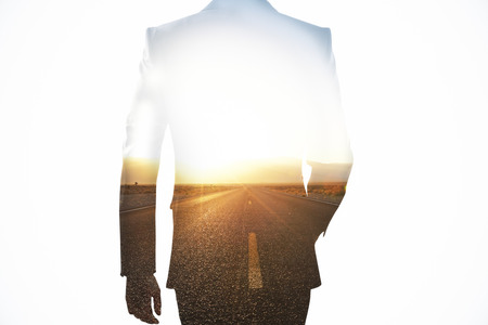 Back view of businessman on road background. Direction concept. Double exposure
