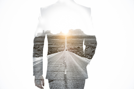 Back view of businessman on road background. Success concept. Double exposure Stok Fotoğraf