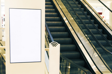 Close up of blank banner in interior with escalator. Mock up. Toned image