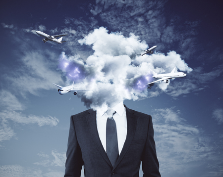 Cloud headed businessman with airplanes on sky background. Travel concept