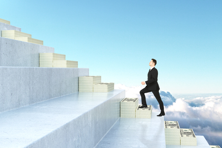 Side view of young businessman climbing abstract money staircase on sky background. Financial growth concept. 3D Rendering