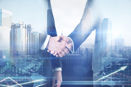 Businessmen shaking hands on abstract city and forex chart background. Teamwork concept. Double exposure Stock fotó - 78063047