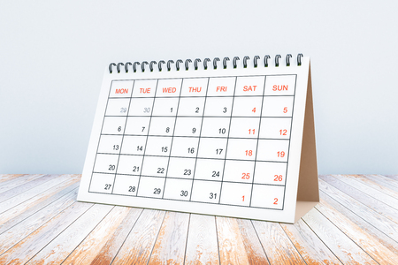 Calendar placed on wooden surface. Schedule concept. 3D Rendering