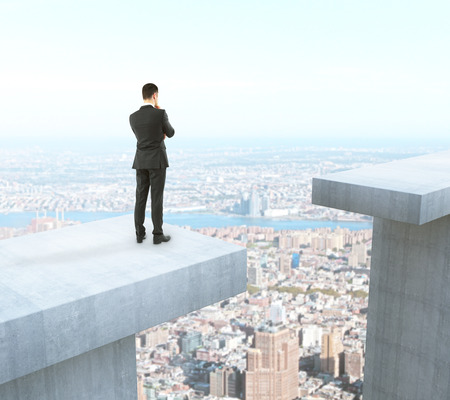 Businessman thinking how to overcome gap on city background. Difficulty concept. 3D Rendering Imagens