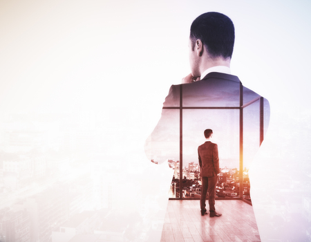 Back view of young businessman looking into the distance on light city background with copy space. Research concept. Double exposure 版權商用圖片 - 78680025