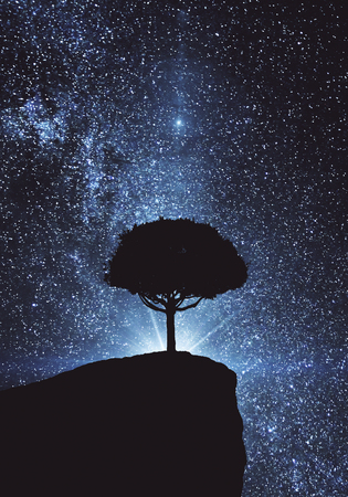 Abstract silhouette of tree on cliff. Blue space background. Creativity concept
