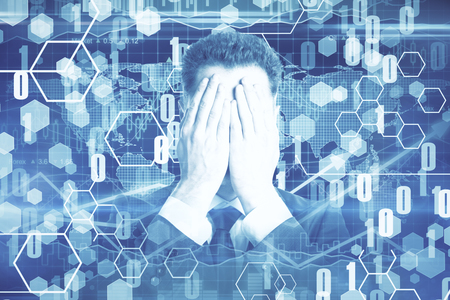 Businessman covering face on abstract digital wallpaper