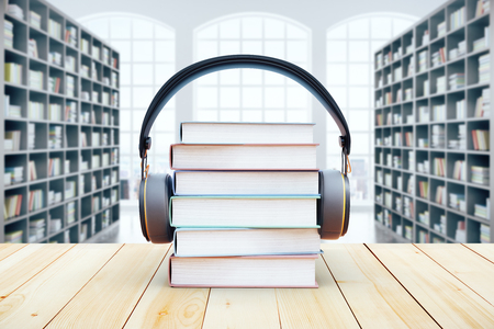 Book pile with headphones on bookshelves background. 3D Rendering. Audio books concept