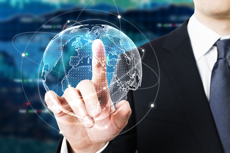 Businessman pointing at digital globe on forex background. Fund management concept. 3D Rendering 写真素材