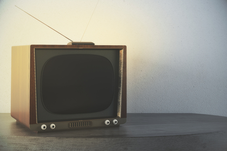 Close up of old TV placed on grey table. Concrete wall background. Mock up, 3D Rendering Reklamní fotografie