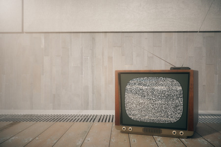 Close up of retro TV screen places on wooden floor. Technology concept. 3D Rendering
