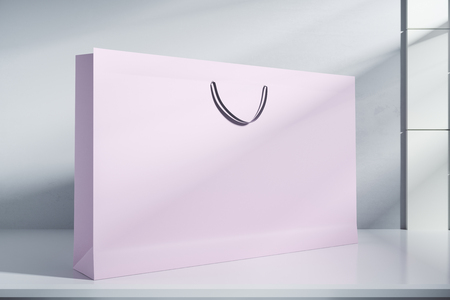 Close up of pink shopping bag on concrete background. Copy space. Store concept, 3D Rendering