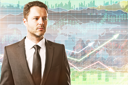 Portrait of handsome young businessman on forex chart background. Trading concept