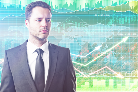 Portrait of handsome young businessman on forex chart background. Sales concept