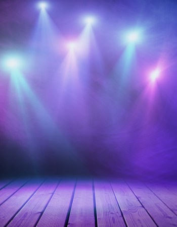 Wooden stage with purple smoke and spotlights. Presentation concept Stock Photo