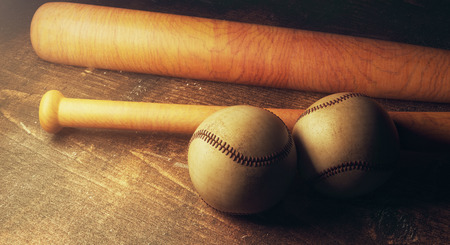 Close up of two baseballs and bats on wooden table. Equipment concept. 3D Rendering
