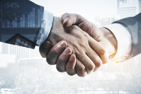 Side view of handshake on abstract city background with business/forex chart. Financial union concept. Double exposure