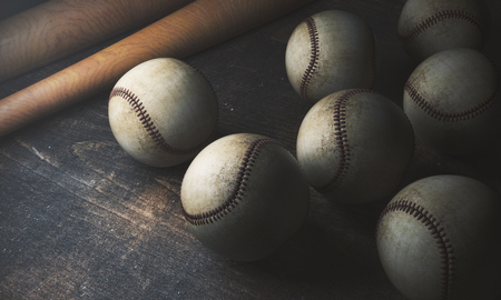 Close up of numerous baseballs and bats on wooden table. Game concept. 3D Rendering