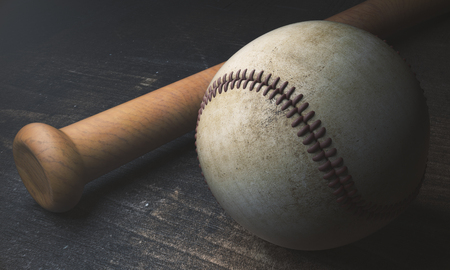 Close up of baseball and bat on aged wooden surface. 3D Rendering
