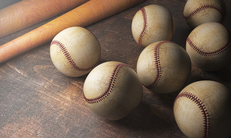 Close up of numerous baseballs and bats on wooden desk. Game concept. 3D Rendering