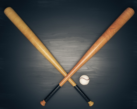 Crossed bats and baseball on dark wooden table. 3D Rendering