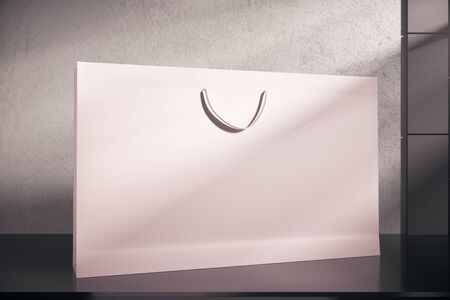 Close up of pink shopping bag on concrete background. Copy space. Ad concept, 3D Rendering