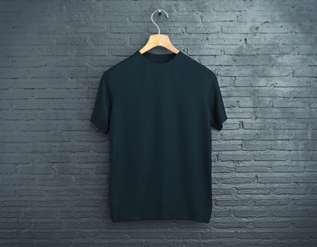 Wooden hanger with empty black t-shirt hanging on dark brick background. Retail concept. Mock up. 3D Rendering