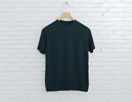Wooden hanger with empty black t-shirt hanging on light brick background. Clothing concept. Mock up. 3D Rendering Stock Photo