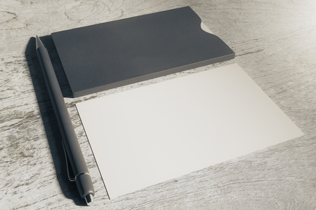 Close up of black and white business cards and pen on wooden table. Toned image. Mock up, 3D Rendering