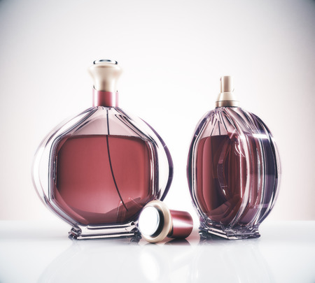 Two brown female perfume bottle and cap on light background with reflections. Lifestyle and fashion concept. 3D Rendering Reklamní fotografie