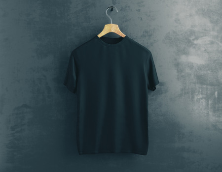 Wooden hanger with empty black t-shirt hanging on dark concrete background. Clothes concept. Mock up. 3D Rendering