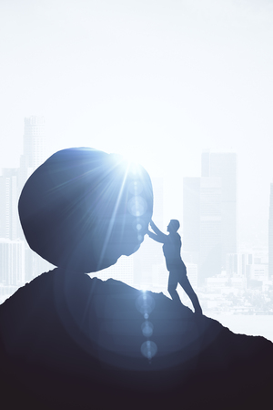 Backlit image of businessman pushing boulder uphill. Bright background with sunlight. Challenge concept. 3D Rendering