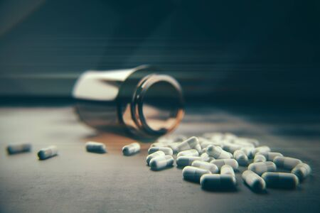 Fallen bottle and scattered pills on concrete background. Addiction concept. 3D Rendering