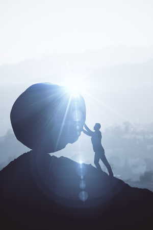 Backlit image of businessman pushing boulder uphill. Bright background with sunlight. Risk concept. 3D Rendering